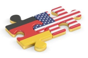 USA and Germany puzzles from flags, relation concept. 3D renderi